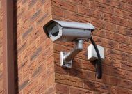 an image of a CCTV camera on the side of a domestic property